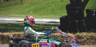Photo of a man riding a go kart