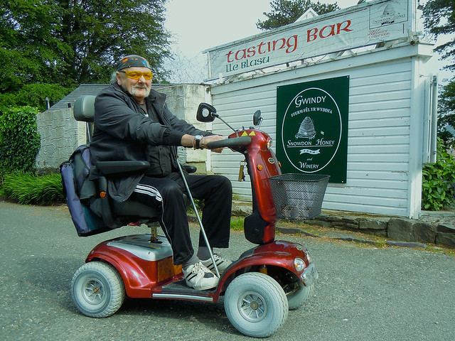 elder riding in a mobility scooter