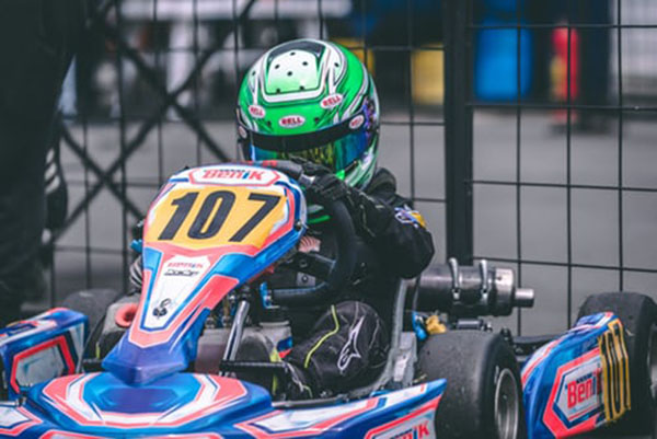 Photo of a man driving a go kart