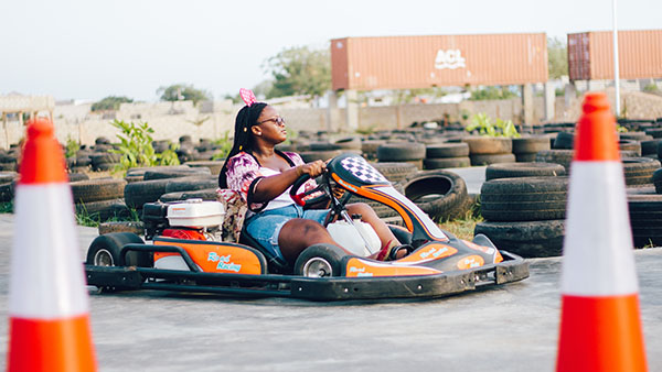woman riding on go kart during daytime