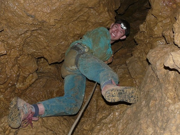 woman in the cave climbing