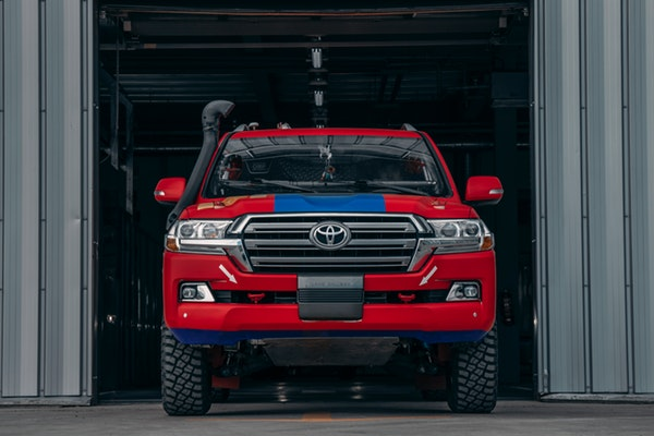 Red Black Toyota off-road truck